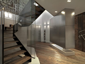 modern entrance with staircase and wood floor